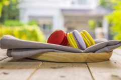 Colorful macaron with cup of tea. Stock Image