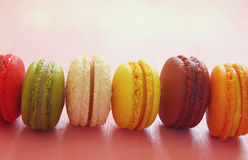 colorful macaron on pink background. Stock Photo
