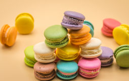 Colorful Macaron sweet and delicious on cream color background Stock Photos