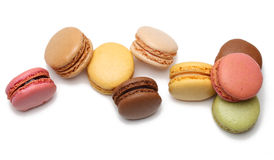 Colorful macarons. Upper view of few colorful macarons against a white background Stock Images