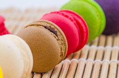 Colorful macarons. On a bamboo mat Stock Images