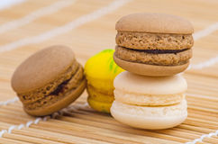 Colorful macarons. On a bamboo mat Royalty Free Stock Image