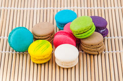 Colorful macarons. On a bamboo mat Royalty Free Stock Photo