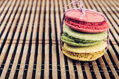 Colorful macarons on a bamboo mat Stock Photo