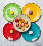 Colorful macarons on bright plate Royalty Free Stock Photography