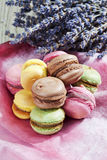 Colorful macarons on cloth and lavender Royalty Free Stock Photos