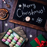 Colorful macarons and coffee on Christmas Stock Image