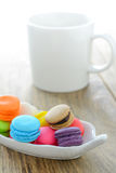 Colorful  Macarons and coffee cup on wood table Royalty Free Stock Photography