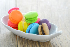 Colorful  Macarons and coffee cup on wood table Stock Images