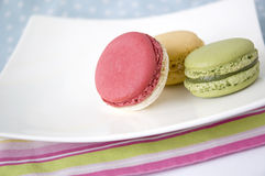 Colorful macarons on color line Stock Photography