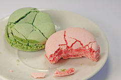 Colorful macarons, crushed and bitten Royalty Free Stock Images