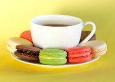 Colorful macaroons with a cup of tea Royalty Free Stock Photo