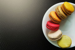 Colorful Macarons in the dish Royalty Free Stock Image