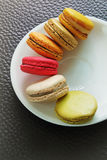 Colorful Macarons in the dish Stock Images