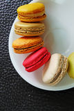 Colorful Macarons in the dish Royalty Free Stock Photography