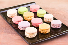Colorful macarons on a lacquer tray Royalty Free Stock Photo
