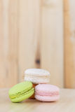 Colorful macarons , macaroons on wooden background. Colorful macaroon , macarons on wooden background royalty free stock image