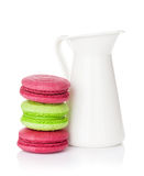 Colorful macarons and milk jug Royalty Free Stock Images