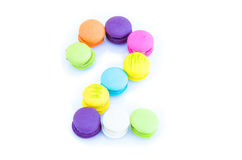 Colorful macarons,number 2 on white background.  Stock Image