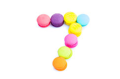 Colorful macarons,number 7 on white background.  Royalty Free Stock Image