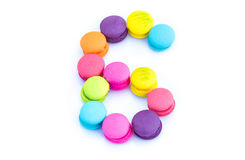 Colorful macarons,number 6 on white background.  Royalty Free Stock Photography