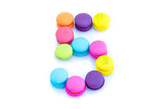 Colorful macarons,number 5 on white background.  Stock Photo