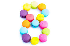 Colorful macarons,number 8 on white background.  Royalty Free Stock Image