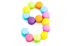 Colorful macarons,number 9 on white background.  Royalty Free Stock Photography