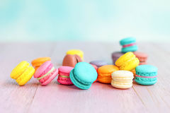 Colorful macarons on a pink wooden table Stock Images