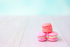 Colorful macarons on a pink wooden table Royalty Free Stock Image