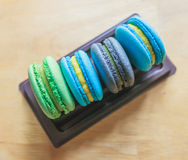Colorful macarons on plastic tray Stock Image