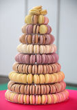 Colorful macarons on pyramid-shaped plastic stand on many visibl Stock Photo