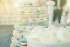 Colorful macarons on pyramid-shaped plastic stand Stock Photography