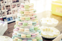 Colorful macarons on pyramid-shaped plastic stand Royalty Free Stock Image