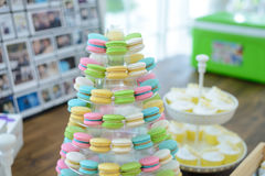 Colorful macarons on pyramid-shaped plastic stand Royalty Free Stock Photo