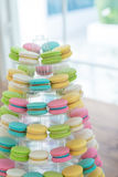 Colorful macarons on pyramid-shaped plastic stand Royalty Free Stock Photography