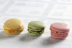 Colorful macarons in a row Stock Image