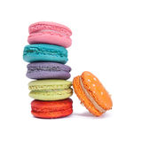 Colorful macarons row on white background. A roll of colorful macarons on white background royalty free stock image