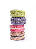 Colorful macarons row on white background. A roll of 4 colorful macarons on white background royalty free stock image