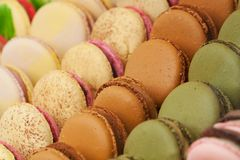 Colorful macarons in the shop window. Tasty colorful appetizing lie on the shop window or in a cafe royalty free stock images