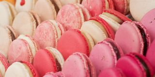 Colorful macarons in the shop window. Tasty colorful appetizing lie on the shop window or in a cafe stock photo
