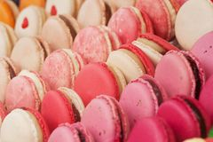Colorful macarons in the shop window. Tasty colorful appetizing lie on the shop window or in a cafe royalty free stock photos