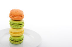 Colorful macarons on a white plate stock image