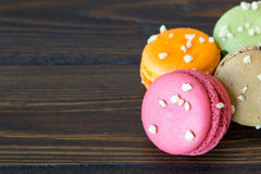 Colorful macarons on wood table Stock Images