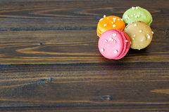 Colorful macarons on wood table Royalty Free Stock Images