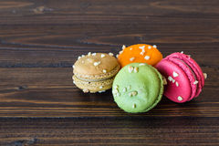 Colorful macarons on wood table Stock Photos