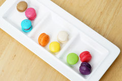 Colorful macarons. On wooden background Royalty Free Stock Photography