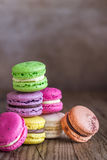 Colorful macarons on the wooden background Royalty Free Stock Photo