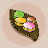 Colorful macaroon on brown plate. Stock Image