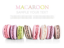 Colorful macaroon cake in a row isolated not a white background Stock Photography